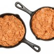 Refried Beans in Skillets Over White — Stock Photo #42550611