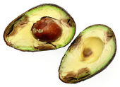 Overly Ripe Avocado Sliced with Seed Over White — Stock Photo
