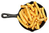 Oven Baked Crinkle Fries in Cast Iron Skillet — Stock Photo