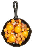 Raw Eggs, Cheese and Sausage in Cast Iron Skillet — Stock Photo