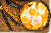 Skillet Baked Eggs and Sausage with Cheese — Stock Photo