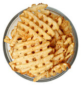 Bowl of Waffle Fries Over White — Stock Photo