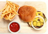 Top View Burger and Fries on Cutting Board — Stock Photo