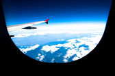 Wing of airplane from plane window — Stock Photo