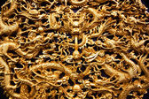 Golden dragon sculpture carving — Stock Photo