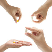 Hand of a woman holding a pill — Stock Photo