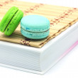 Macaroon put on the books — Stock Photo