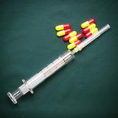 Medical syringe and capsules — Stock Photo