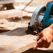 Electric saw cutting wood — Stock Photo