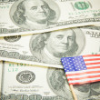 One hundred dollars with USA flag — Stock Photo