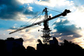 Silhouettes of Industrial construction crane — Stock Photo