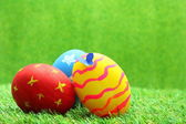 Easter eggs on grass background — Stock Photo