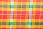 Kleurrijke lendendoek stof achtergrond — Stockfoto