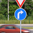 Stock Photo: Moving car and traffic signs