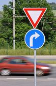 Moving car and traffic signs — Stock Photo