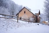 Old house covered in snow — Stock Photo