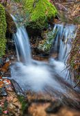 Small spring waterfall — Stock Photo