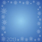 Christmas frame with snowflakes on a blue back 2013 — Stock Photo