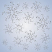 Christmas snowflakes on a blue-gray background — Stock Photo