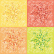 Christmas snowflakes in red, yellow, range, green on a scratch o - Stock Photo