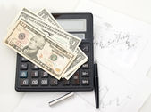 Chart, calculator, pen. Dollars. — Stock Photo