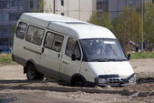 Minibus on cunning russian road — Stock Photo