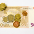 图库照片: Euro banknote and coins