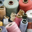 Many different reels of thread for sew - Stock Photo