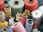 Many different reels of thread for sew — Stock Photo