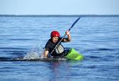 Sportsman trains on the kayak — Stock Photo