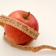 Red apple with measuring tape — Stock Photo