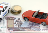 Toy car, money and documents — Stock Photo