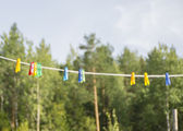 Clothespins on a rope — Stock Photo