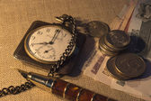 The money, pen and retro poket watch — Stock Photo