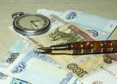 Pocket watches, pen and money — Stock Photo