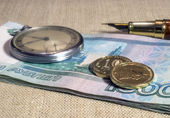 Business still-life with money and watch — Stock Photo