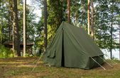 Oldschool soviet tent in nothern forest — Stock Photo