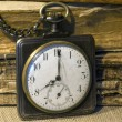 Stock Photo: Retro pocket watch and tattered folios