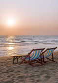 Deck chairs on the sea beach — Stock Photo
