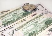 Some dollars and old watch — Zdjęcie stockowe