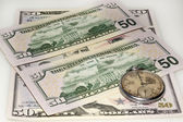 Dollar bank bills and old watch — Stock Photo