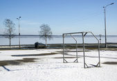 Football gate near lake in spring — Stock fotografie