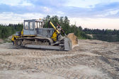 Dozer in the sand extraction place — Stock Photo
