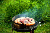 Sausages on the smoking gril — Stock Photo