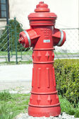 A hydrant close to old castle — Stock Photo