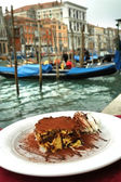 Tiramisu cake on Venice canal background — Stock Photo