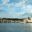 Prague. Charles bridge and spires of the old town — Stock Photo #14691175