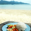 Rice with seafood and vegetables on sea landscape background — Stock Photo