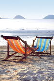 Two sunbeds on the beach in the evening sun — Stock Photo