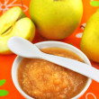 Royalty-Free Stock Photo: Homemade apple puree in a bowl on colorful tablecloth